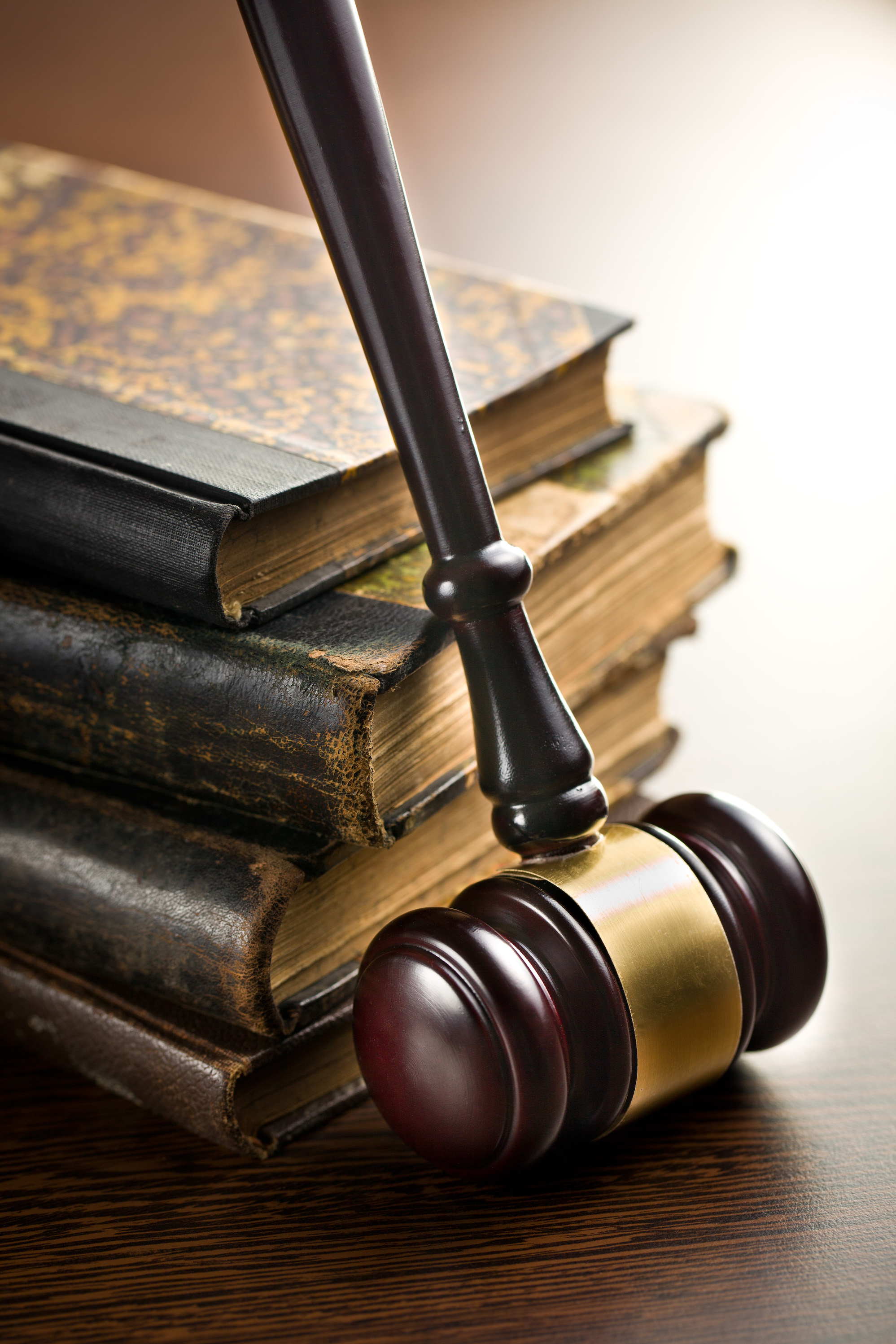 judge gavel with old books